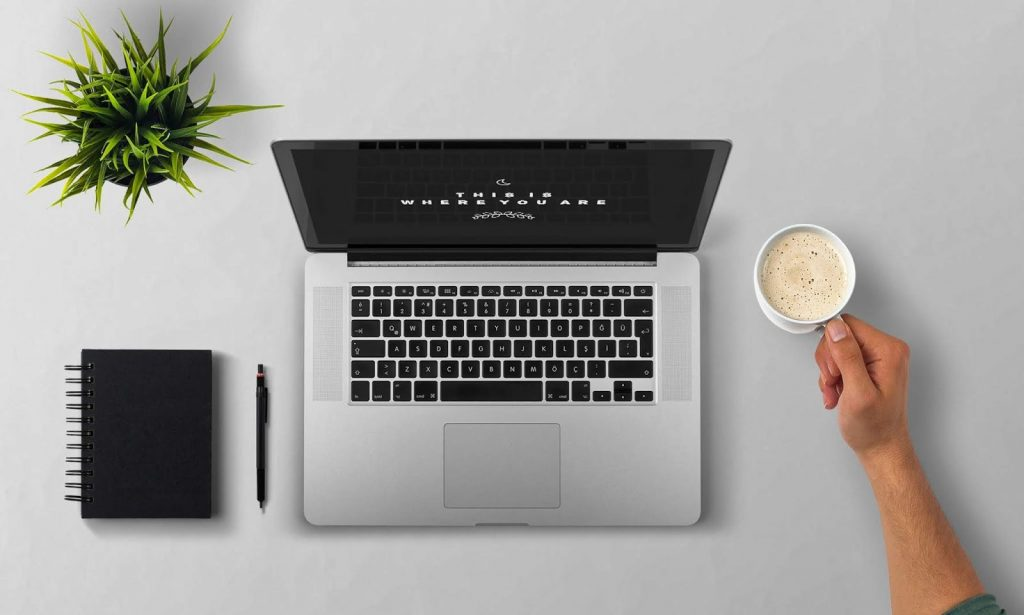 man-using-laptop-on-table-against-white-background-257897
