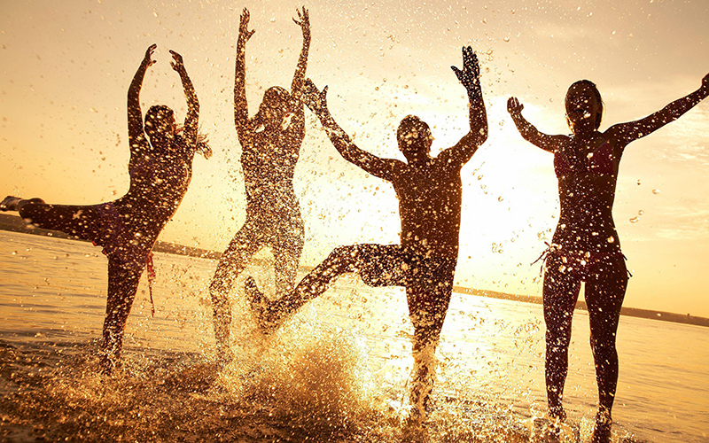 Happy People dancing in the water